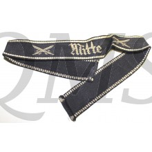 "achine woven ""Mitte"" cufftitle in silver/grey thread on a dark blue/black background with crossed swords to either side of the script. Bordered on both the top and button in silver/grey threads. Cufftitle is full length an uncut, approximately 40cm. Excel"