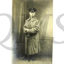Studio portter German Soldier in greatcoat with sabre