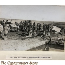 Press photo , front of Mesopotamia,, Water carriers