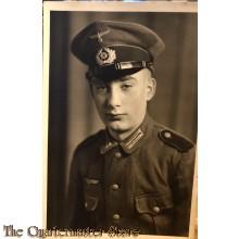 Studio photo Wehrmacht soldier  wearing visorcap