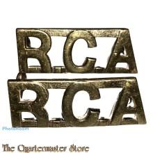 Shoulder titles R.C.A. (brass)