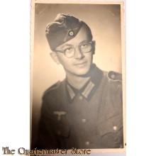 Studio portret soldier with oversea's cap
