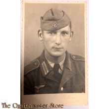 Studio portret soldier with tie and wedged cap