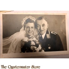 Studio portret decorated LW NCO and Bride