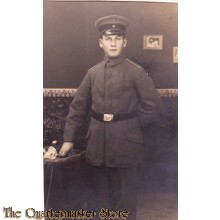 AnsichtsKarte (Mil. Postcard) Soldier posing at table 1916