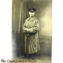 Studio portter German Soldier in greatcoat with sabre