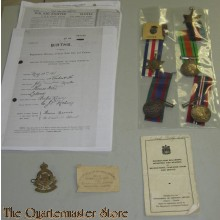Medals badges and paperwork of Pvt R.P. Ferrie R.C.O.C. 5th Division Holland